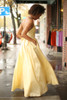 Midnight Glamour Yellow Satin Gown with Rhinestone Band side view.