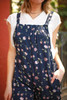 Flower Girl Navy Floral Printed Jumpsuit with Pockets detail view.