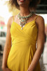 Goddess in Gold Mustard Chiffon Maxi Dress front detail view.