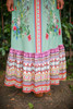 Siesta Dreams Sage Floral Printed Off Shoulder Maxi Dress bottom detail view.