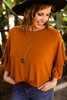 All for the Ruffles Amber Tunic Top front view.