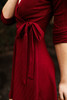 All That Shimmers Burgundy Wrap Dress side detail view.