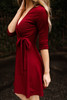 All That Shimmers Burgundy Wrap Dress side view.
