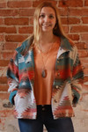 The Avery Jayne Geometric Print Wanderer Jacket in Teal.