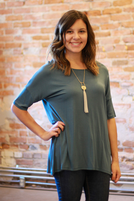 Teal short sleeve high low tunic front view.
