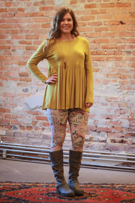 Dark mustard long sleeve ruffle tunic full body front view.