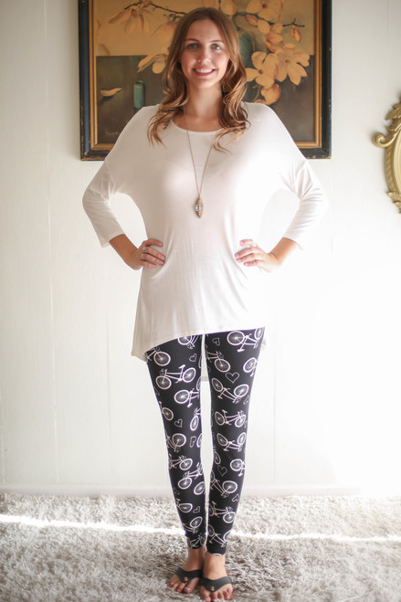Simply Basics Off White Slouchy 3/4 Sleeve Top full body front view.