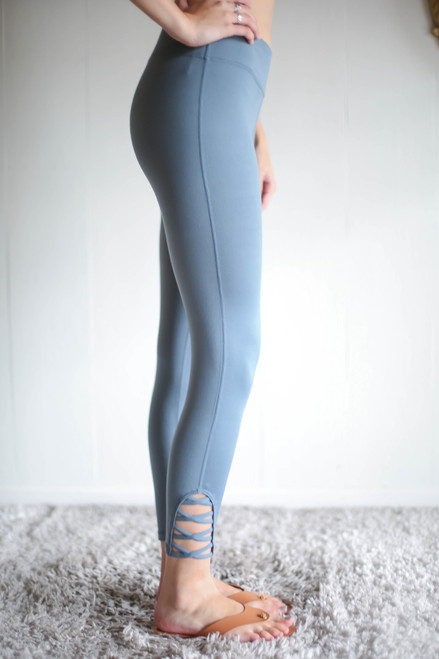 Activated Athletics Light Teal Blue Leggings with Crossed Detail side view.