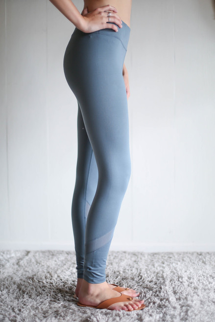 Activated Athletics Teal Mesh Streak Leggings side view.