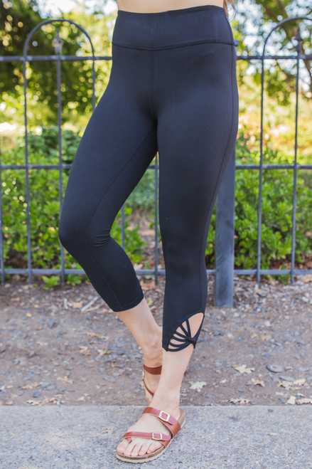 Activated Athletics Black Capri Leggings with Webbed Strap Detail front view.