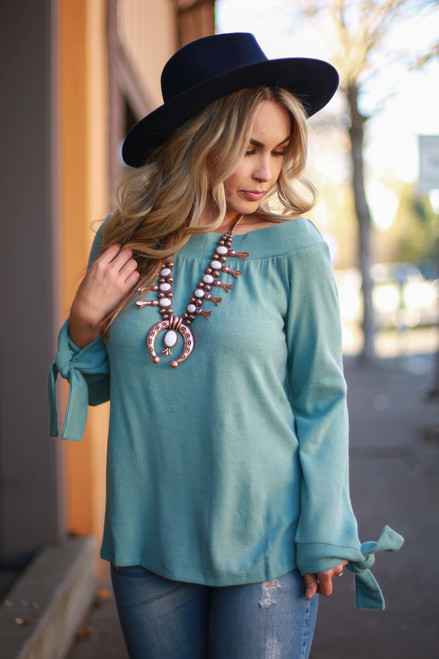 Sassy in Sage Off Shoulder Top with Wrist Ties front view.