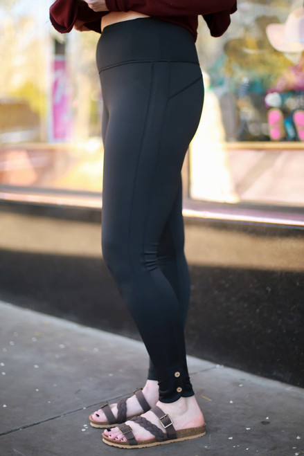 Activated Athletics High Waist Black Leggings with Buttons side view.