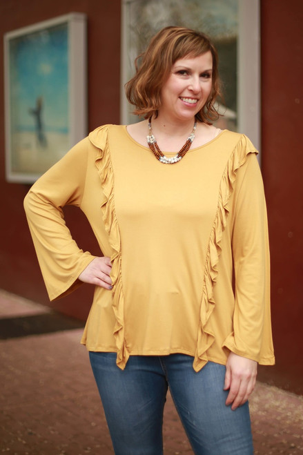 Ruffle Revelations Mustard Long Sleeve Top front view.