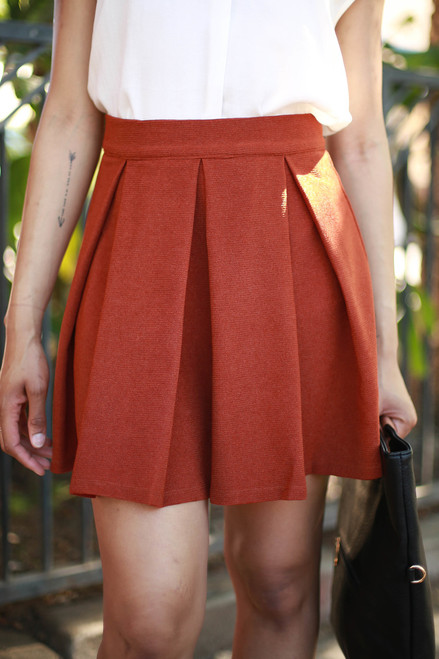 Twirl in Terracotta Pleated A-Line Skirt front view.