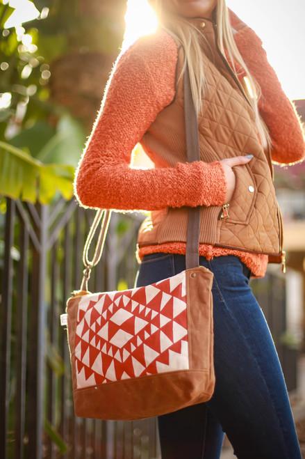 Rachel Elise Rust Bowtie Courier Bag front view.