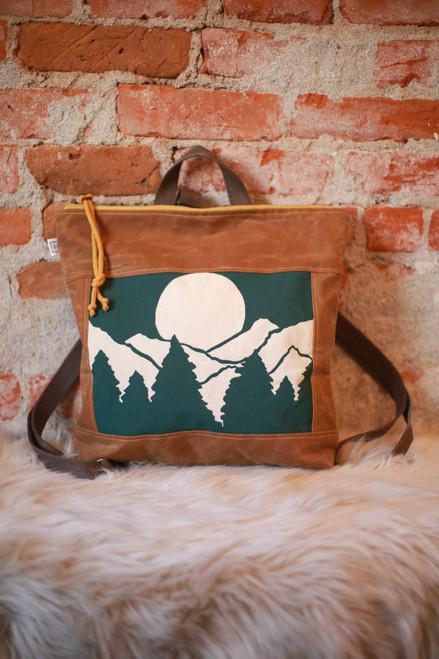 Rachel Elise Forest Vista Bucket Backpack front view.