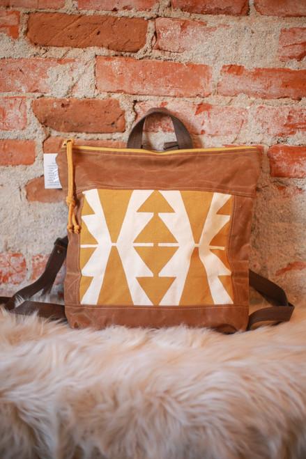 Rachel Elise Mustard Casita No. 2 Bucket Backpack front view.