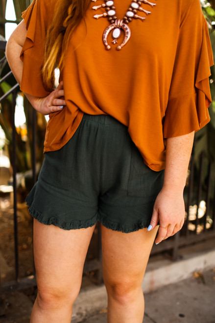 Hold Onto Summer Seaweed Green Shorts front view.