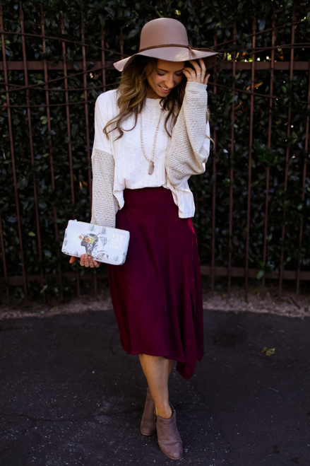 Strut Your Stuff Maroon Asymmetrical Suede Midi Skirt front view.