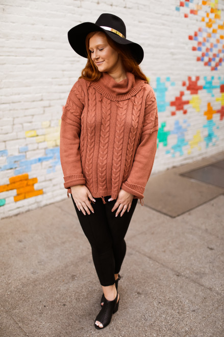 Cozy in Canyon Clay Turtleneck Knit Sweater full body front view.