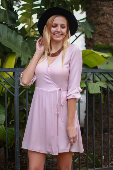 Flirty in Frills Blush V-Neck Wrap Dress front view.