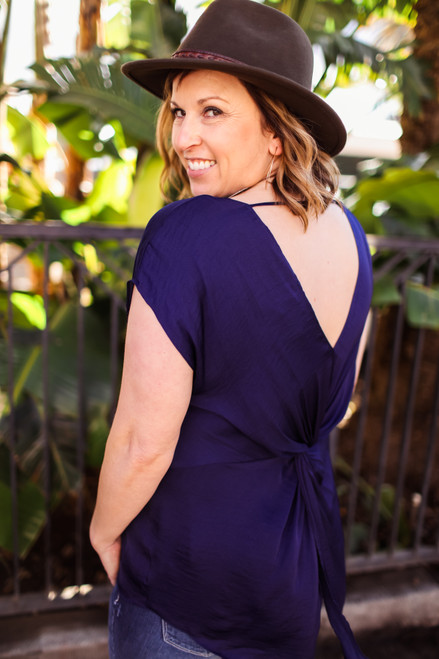 High Stakes Deep Navy High Low Blouse with Twist Back back view.