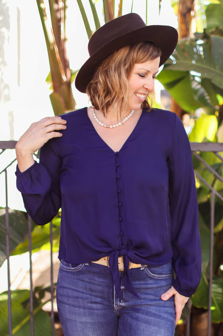 Powerful Being Deep Navy Button Down Long Sleeve Blouse with Tie front view.