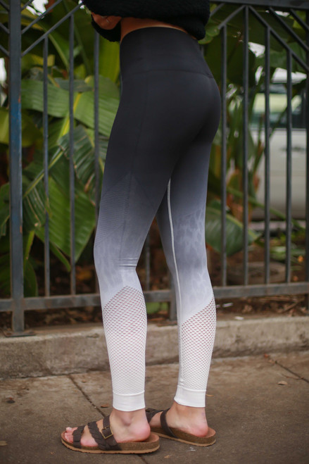 Activated Athletics Black and White Ombre Leopard Perforated Leggings side view.