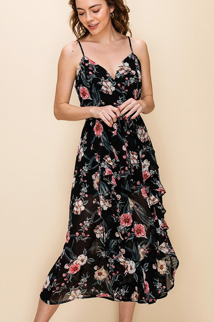 Floral culotte jumpsuit with ruffle trim detail.