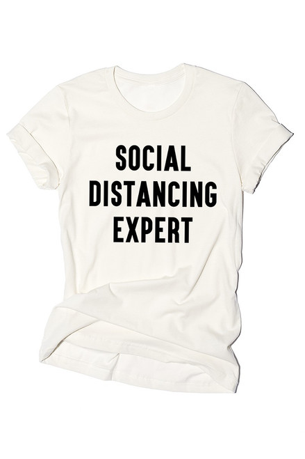 "Vintage white unisex's short sleeve graphic tee featuring a fun graphic design reading ""Social Distancing Expert """