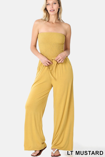 Light mustard smocked tube top jumpsuit with pockets and elastic waistband.