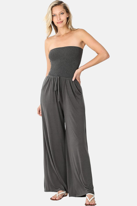 Ash grey smocked tube top jumpsuit with pockets and elastic waistband.