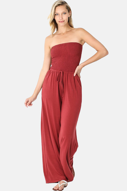 Brick smocked tube top jumpsuit with pockets and elastic waistband.