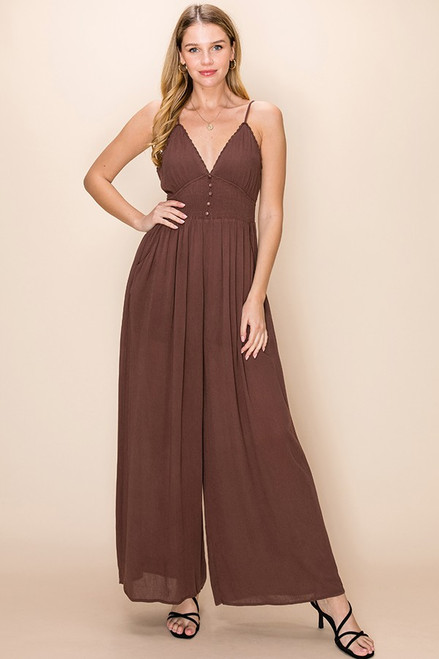 Chocolate Brown Deep-V smocked waist jumpsuit with button front and lace trim detail.
