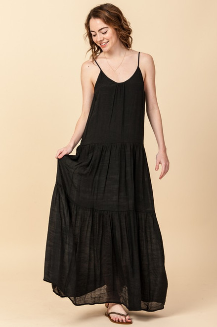 Black tiered maxi dress featuring adjustable spaghetti straps and single button key hole closer.
