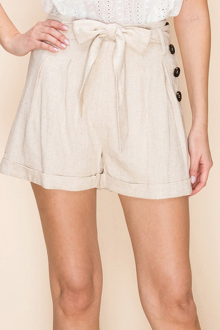 Oatmeal cuffed paper bag shorts with button detail and tie