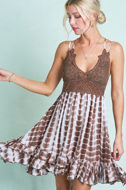 Chocolate Brown crochet tie-dye mini dress with a smocked back giving it a perfect fit. This dress has adjustable straps and removable bra pads making the fit flexible.