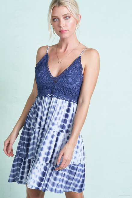 Blue tie-dye mini dress with a smocked back giving it a perfect fit. This dress has adjustable straps and removable bra pads making the fit flexible.