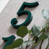Sentinel slab serif font traditional in green for house numbers, letters and signs