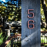 Very modern house number 5 and 6 in copper cast aluminum. Depth is thick and the stroke of the font is thin