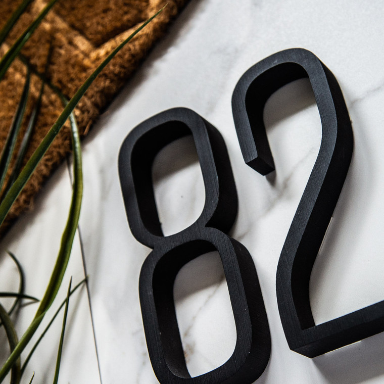 Tungsten Light is a modern tall thin condensed typeface for house numbers, letters or signs