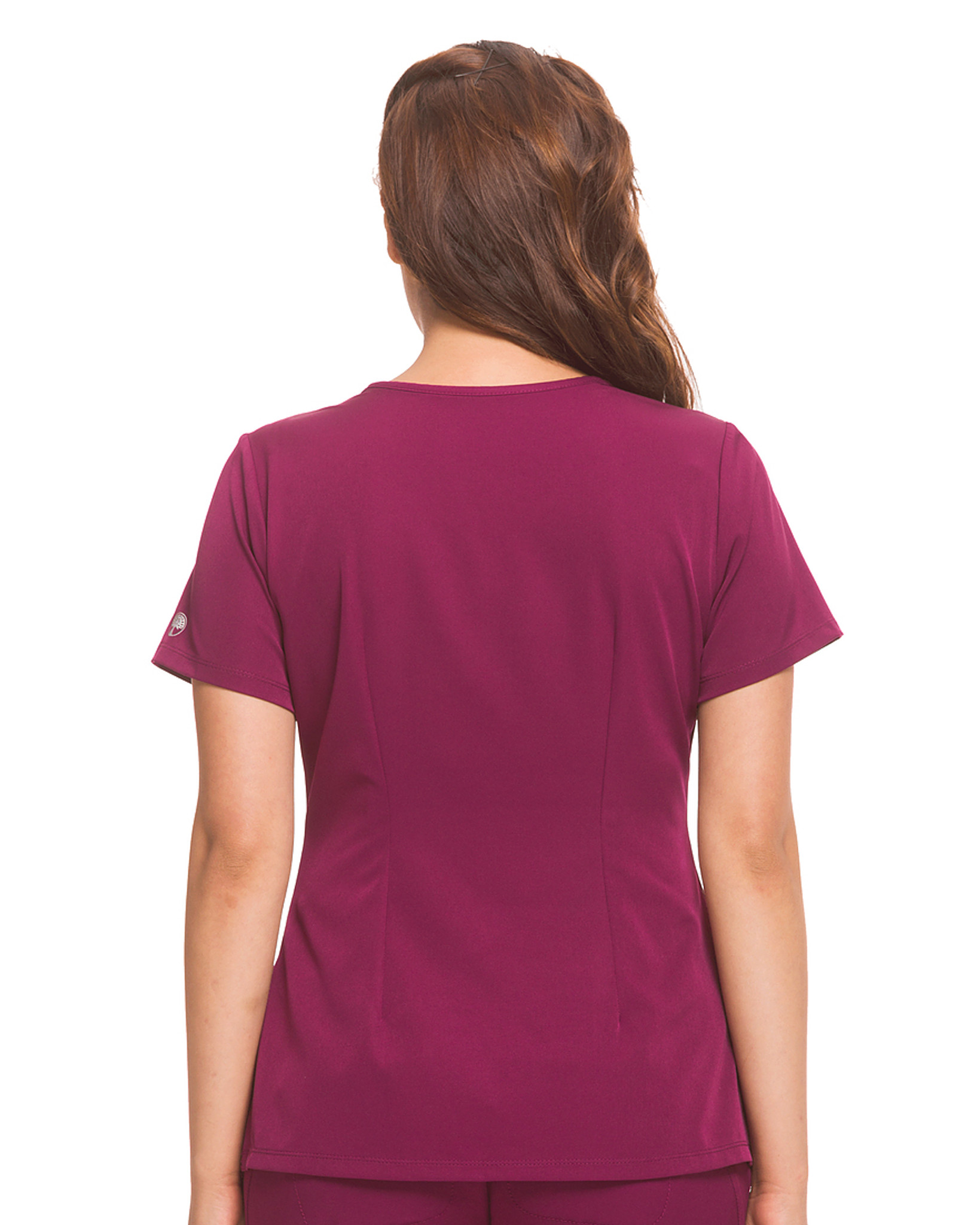 Healing Hands HH Works 2500 Monica Women's Scrub Top with v-neck, princess seams, and two pockets, spandex stretch and four way stretch. Model image back.