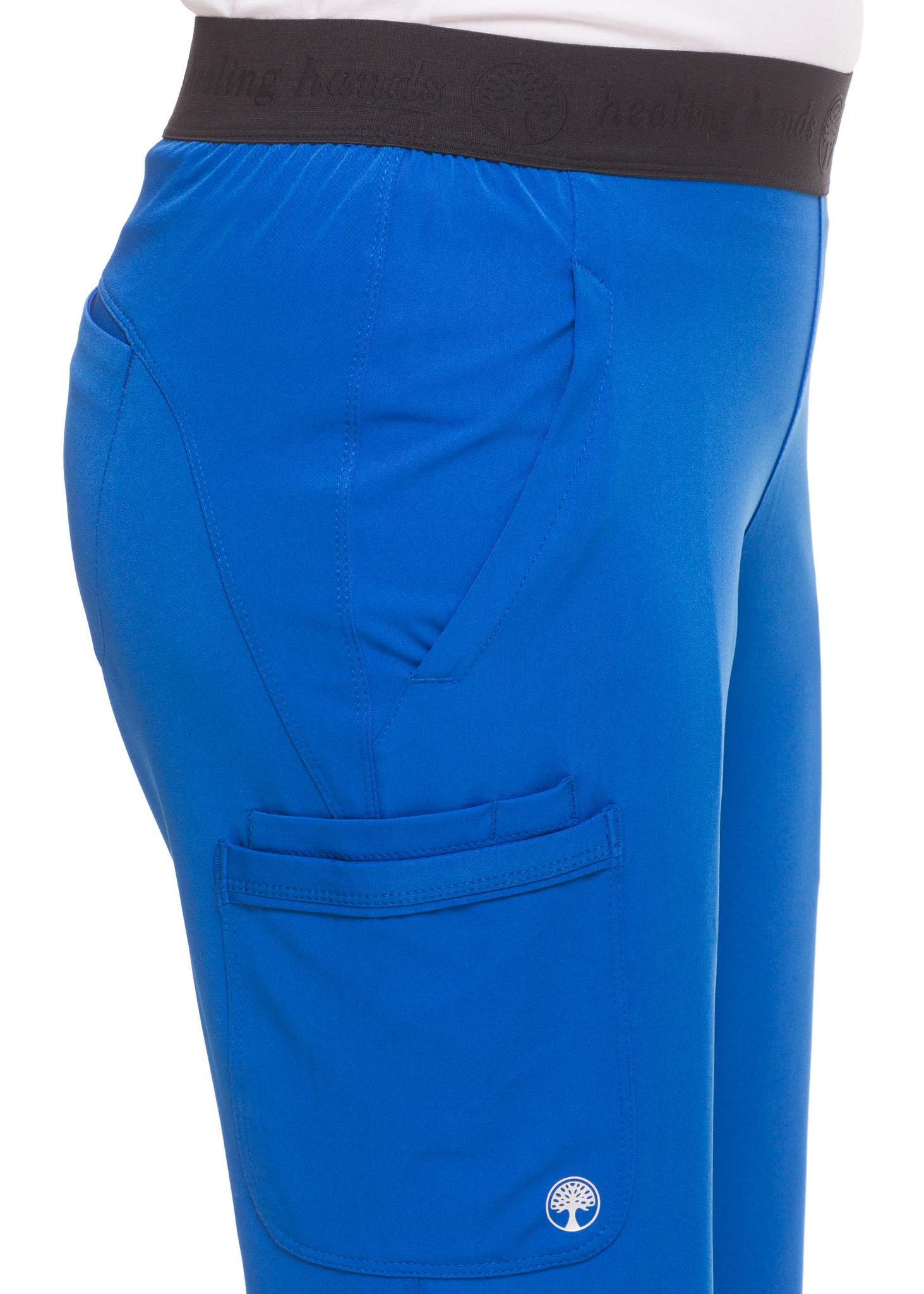 Healing Hands HH Works 9500 Rachel Women's Scrub Pant with 6 pockets including double cargo pockets and double back pockets, elastic waist, straight leg, and four way spandex stretch. Model image right detail.