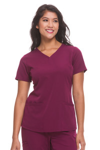 Healing Hands HH Works 2500 Monica Women's Scrub Top with v-neck, princess seams, and two pockets, spandex stretch and four way stretch. Model image front.