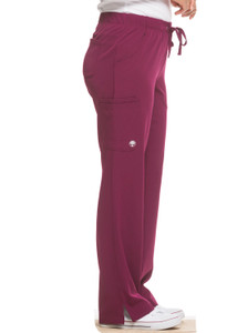 Healing Hands HH Works 9560 Rebecca Women's Scrub Pant featuring Drawstring tie front with elastic back, straight leg with ankle vents, five pockets including two back pockets and a cargo pocket, and four way spandex stretch. Model Image left side
