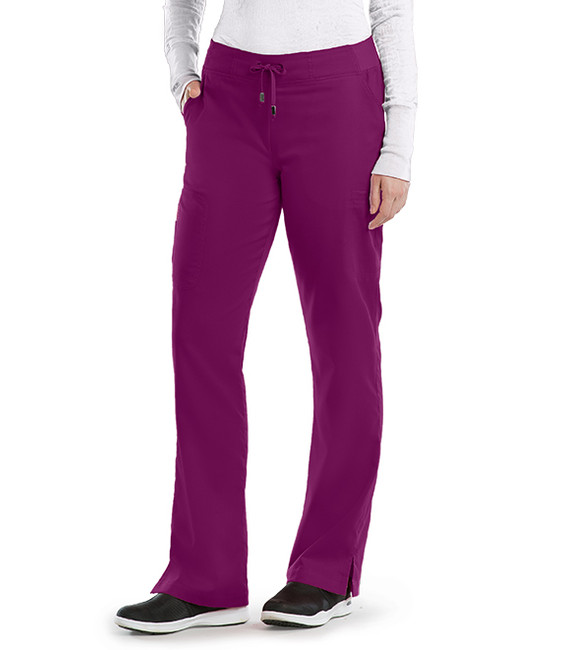 Barco Grey's Anatomy women's scrub pants wide knit elastic waist for unbelievable comfort and six pockets for all your workday necessities, includes a double cargo pockets, one with a zipper, to keep bulk out of the way. The modern rise and gentle stretch polyester/rayon mean you move freely throughout the day. Style 4277 on Model.