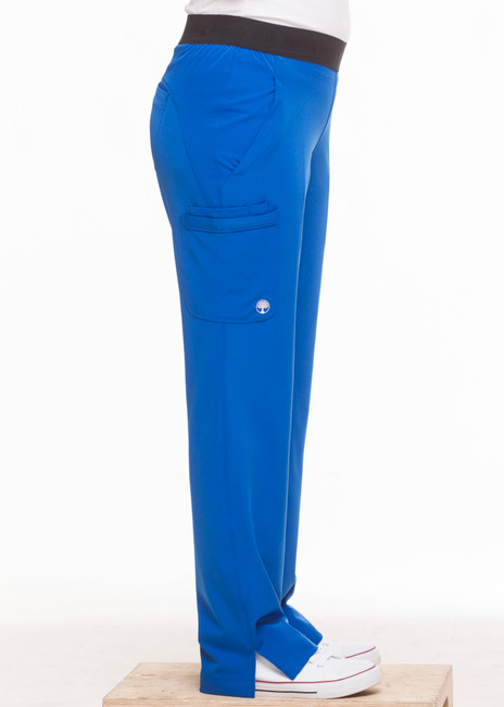 Healing Hands HH Works 9500 Rachel Women's Scrub Pant with 6 pockets including double cargo pockets and double back pockets, elastic waist, straight leg, and four way spandex stretch. Model image left side.