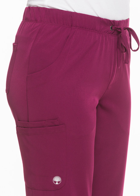 Healing Hands HH Works 9560 Rebecca Women's Scrub Pant featuring Drawstring tie front with elastic back, straight leg with ankle vents, five pockets including two back pockets and a cargo pocket, and four way spandex stretch. Model Image detail.