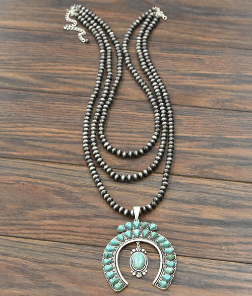 Turquoise Squash Blossom necklace on navajo beads