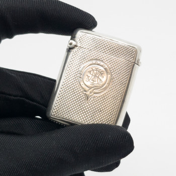 This sterling silver vesta case is inscribed on the front with 1910 and some initials, however the hallmarks point to it possibly being made in 1896 in Birmingham England. It carries the hallmark of the manufacturer M Bros.